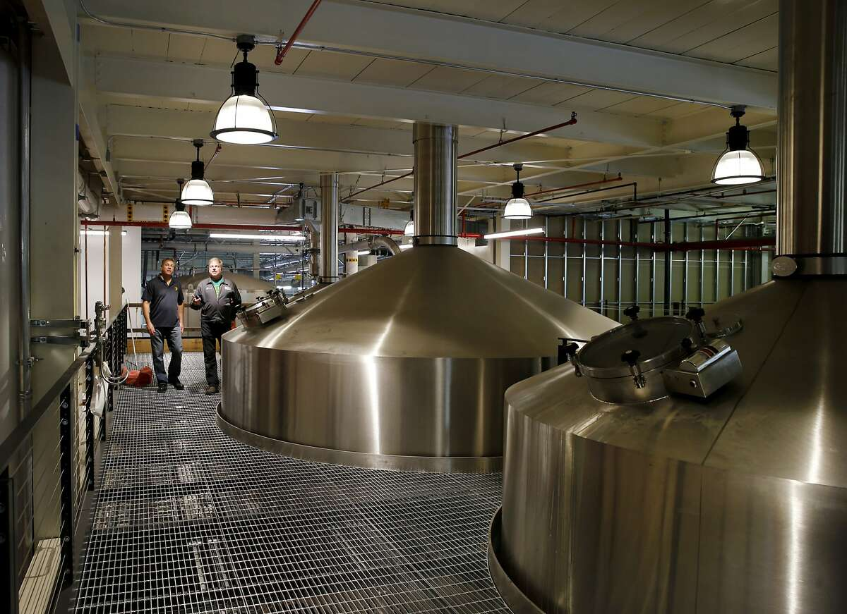 Large stainless vats extend to the second floor where the brewing magic takes place Monday June 1, 2015. 21st Amendment Brewery is opening a massive and ambitious multi-million dollar facility in San Leandro, Calif. at the site of the former Kellog Cereal factory.
