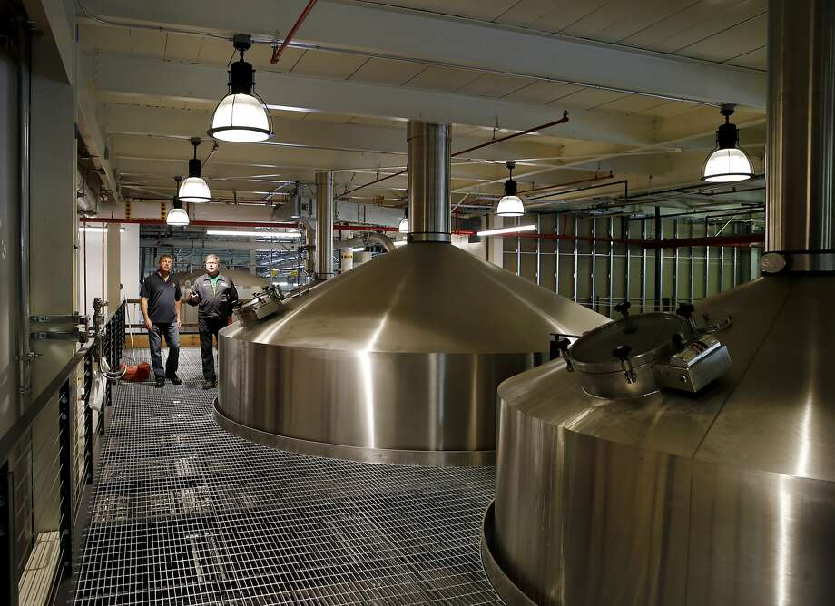 Large stainless vats extend to the second floor where the brewing magic takes place. Photo: Brant Ward, The Chronicle