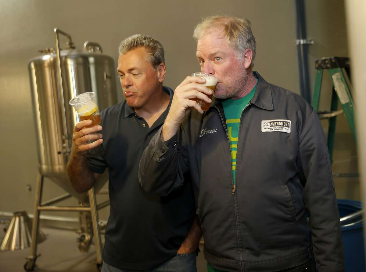 Owners Nico Freccia (left) and Shaun O'Sullivan enjoy a sip of their first IPA brewed at the new facility Monday June 1, 2015. In 2015, 21st Amendment Brewery opened a massive multi-million dollar facility in San Leandro, Calif. at the site of the former Kellogg's Cereal factory.