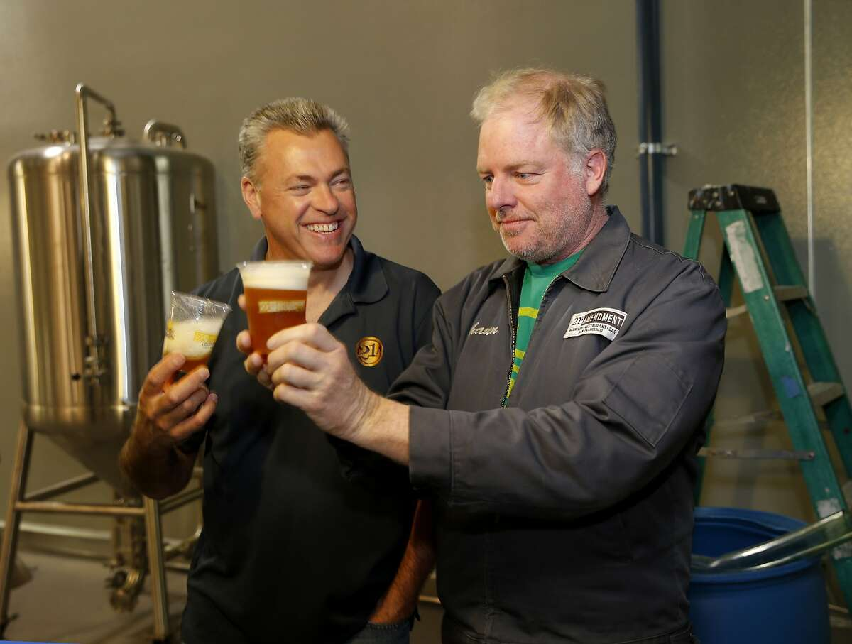 Owners Nico Freccia (left) and Shaun O'Sullivan enjoy a little of the first IPA brewed at the new facility Monday June 1, 2015. 21st Amendment Brewery is opening a massive and ambitious multi-million dollar facility in San Leandro, Calif. at the site of the former Kellog Cereal factory.