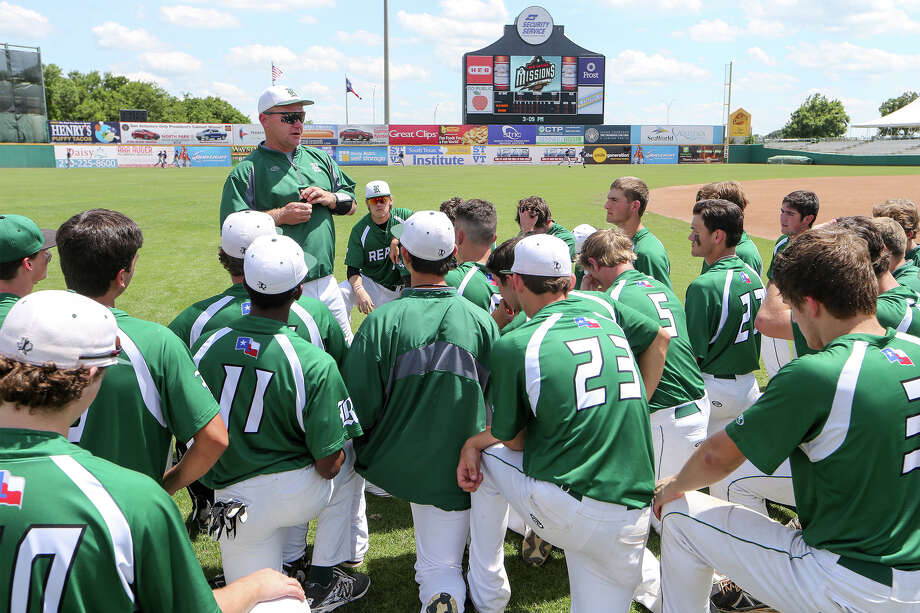 Reagan coach Chans Chapman talks to the team following their Game 2 loss in their 6A fourth-round series with Laredo Alexander at Wolff Stadium on Monday, June 1, 2015.  Alexander advanced with a 6-2 victory over the Rattlers.  MARVIN PFEIFFER/ mpfeiffer@express-news.net Photo: Marvin Pfeiffer, Staff / San Antonio Express-News / Express-News 2015