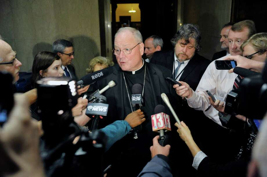 Cardinal Timothy Dolan talks with members of the media in the hallway at the Capitol on Monday, June 1, 2015, in Albany, N.Y.    (Paul Buckowski / Times Union)