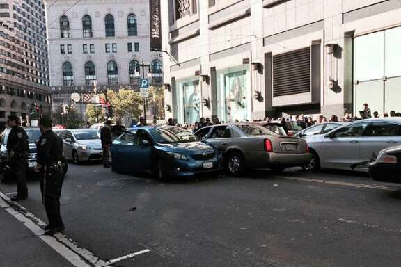 A driver fleeing police crashed a car into traffic on 5th Street between Market Street and Mission Street on Monday, June 1, 2015.