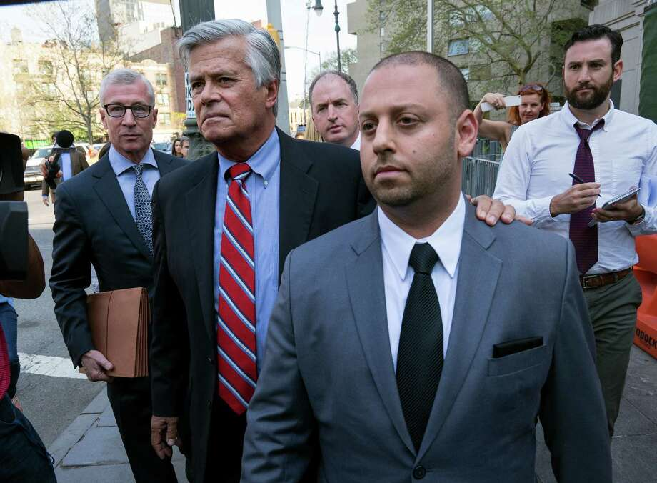 New York Senate Majority Leader Dean Skelos and his son Adam leave federal court in New York, Monday, May 4, 2015, after arraignment on charges including extortion and soliciting bribes amid a federal investigation into the awarding of a $12 million contract. (AP Photo/Craig Ruttle) Photo: Craig Ruttle / FR61802 AP