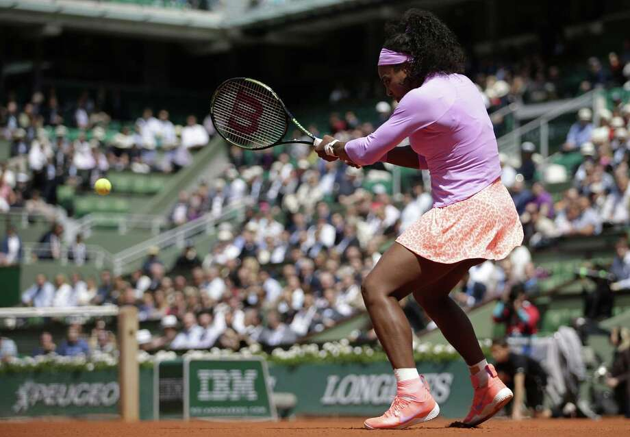 US player Serena Williams returns the ball to US player Sloane Stephens during the women's fourth round of the Roland Garros 2015 French Tennis Open in Paris on June 1, 2015.  AFP PHOTO / KENZO TRIBOUILLARDKENZO TRIBOUILLARD/AFP/Getty Images ORG XMIT: 534885851 Photo: KENZO TRIBOUILLARD / AFP PHOTO
