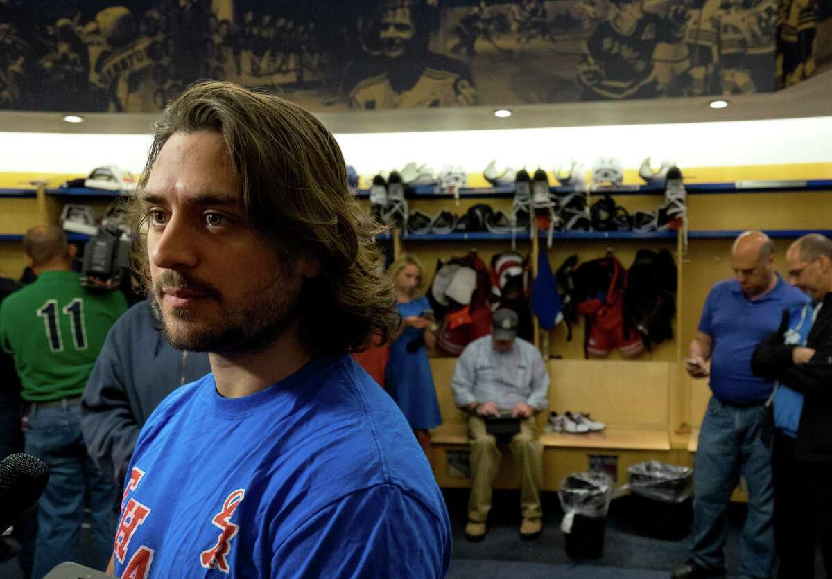 New York Rangers Mats Zuccarello listens to a question in the locker room at the team's Westchester training facility in Greenburgh, N.Y., Monday, June 1, 2015. Zuccarello could not speak for four days after being hit in the head by a shot in the opening round of the Stanley Cup playoffs and sustaining a small skull fracture and some bleeding. (AP Photo/Craig Ruttle) ORG XMIT: NYCR105