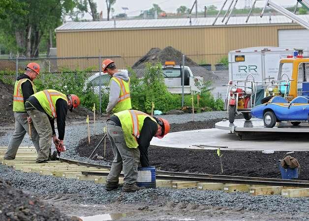 Construction workers build a train track around the new Huck Finn's Playland (formerly Hoffman's Playland) next to Huck Finn's Warehouse on Monday June 1, 2015 in Albany, N.Y. (Lori Van Buren / Times Union) Photo: Lori Van Buren