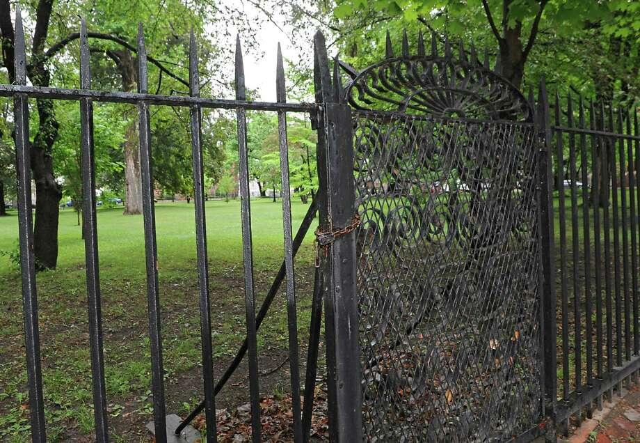 Locked gate of privately owned Washington Park on Monday June 1, 2015 in Troy, N.Y. (Lori Van Buren / Times Union) Photo: Lori Van Buren