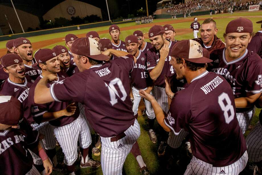 The Texas A&M Aggies celebrate on their home field in College Station after defeating Cal 3-1 on Monday night in the NCAA baseball tournament. Photo: Juan DeLeon, Associated Press