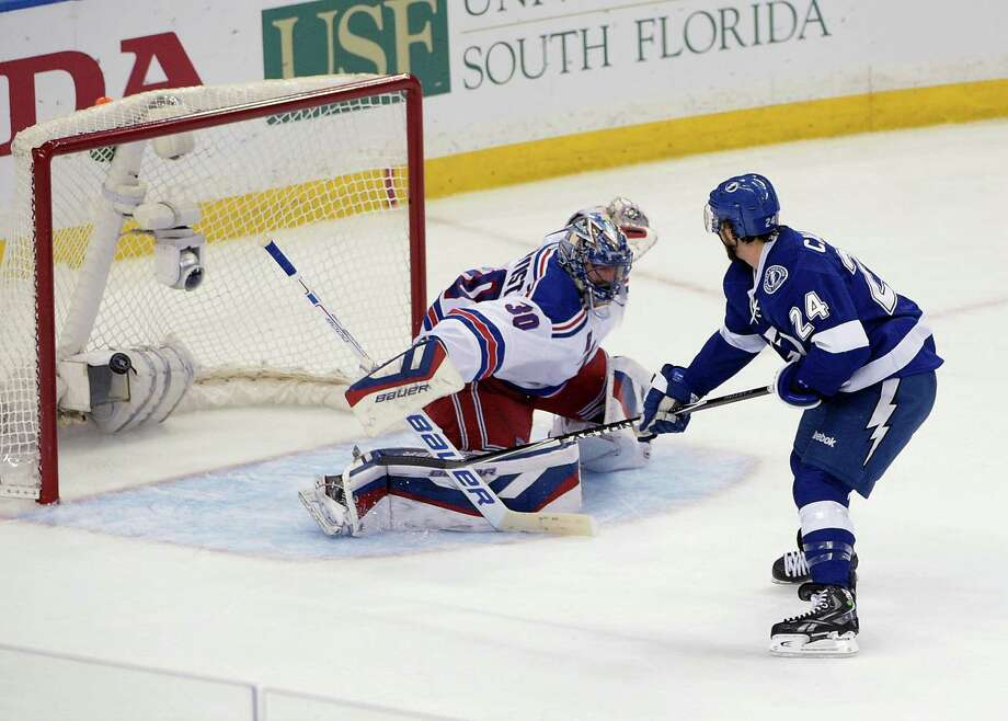 Tampa Bay Lightning right wing Ryan Callahan (24) scores against New York Rangers goalie Henrik Lundqvist (30), of Sweden,during the first period of Game 6 of the Eastern Conference finals in the NHL hockey Stanley Cup playoffs. Tuesday, May 26, 2015, in Tampa, Fla. (AP Photo/Phelan M. Ebenhack) ORG XMIT: TPA108 Photo: Phelan M. Ebenhack / FR121174