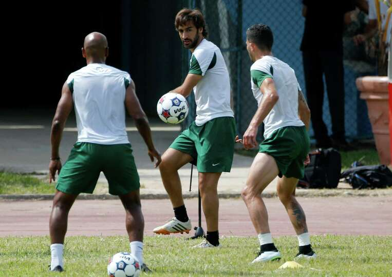 Cosmos players Raul Gonzalez, center, Marcos Senna, left, and Sebastian Guenzatti train ahead of the