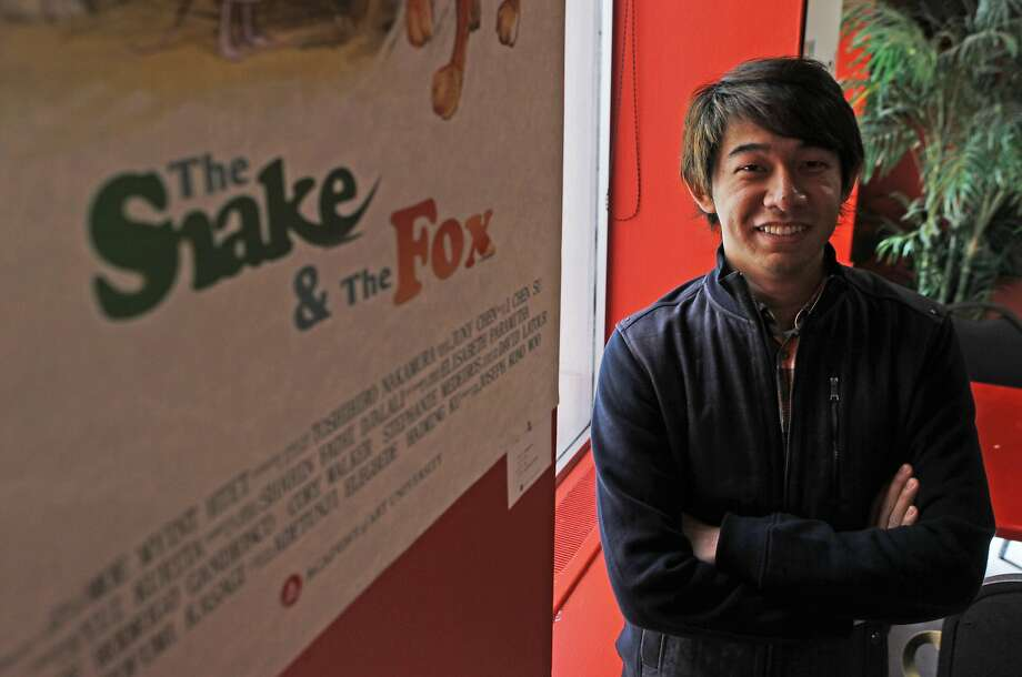 """Moe Myint Htet, creator of the 3-D short film """"The Snake and the Fox,"""" poses with his film poster hanging in the lobby of the Academy of Art campus. Photo: Jessica Christian, The Chronicle"""