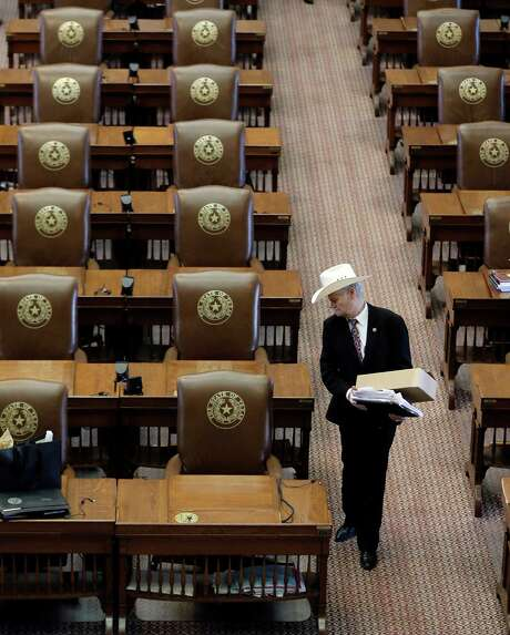 """Rep. Charles """"Doc"""" Anderson, R-Waco, looks back at his desk as he leaves after the House adjourned on the final day of the legislative session in the House Chamber at the Texas Capitol, Monday, June 1, 2015, in Austin, Texas. (AP Photo/Eric Gay) Photo: Eric Gay, Associated Press / AP"""