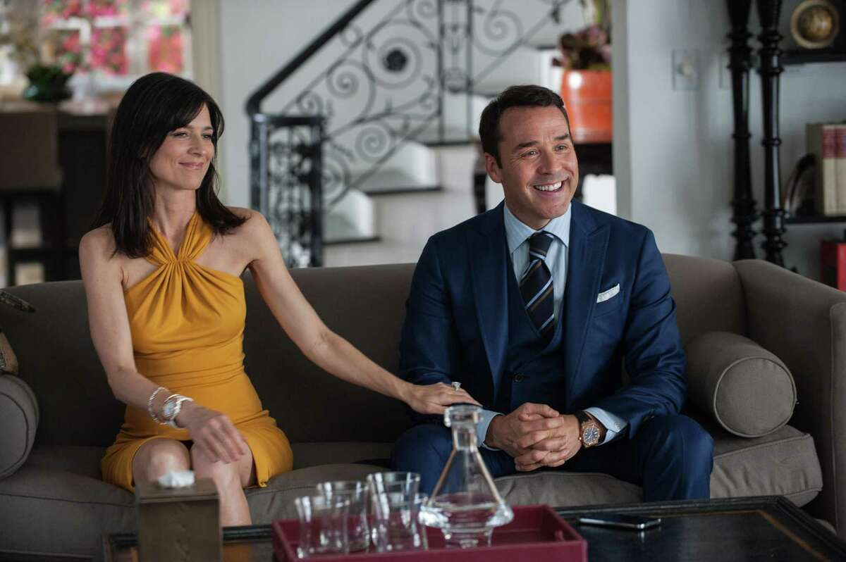 """This photo provided by Warner Bros. Pictures shows, Perrey Reeves, left, as Mrs. Ari, and Jeremy Piven as Ari Gold, in Warner Bros. Pictures,' Home Box Office's and RatPac-Dune Entertainment's comedy """"Entourage,"""" a Warner Bros. Pictures release. (Claudette Barius/Warner Bros. Pictures via AP)"""