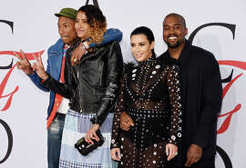(L-R) Pharrell Williams, Helen Lasichanh, Kim Kardashian and Kanye West attend the 2015 CFDA Fashion Awards  at Alice Tully Hall at Lincoln Center on June 1, 2015 in New York City.  (Photo by Dimitrios Kambouris/Getty Images)