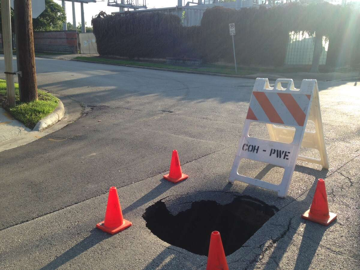 This large sink hole appeared recently at Hyde Park and Mason in the Montrose area. According to Alvin Wright, spokesperson for Houston's public works department, a crew was tending to it midday Tuesday.