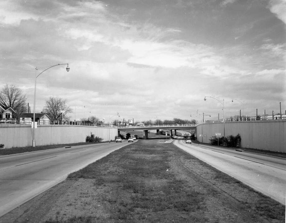 The San Antonio Expressway is shown in this circa 1950s photo. It is on I-10 northwest of downtown. The overpass is Woodlawn Avenue, and just beyond that is Fredericksburg Road. This photo was taken sometime in the 1950s when the roadway was US 87. The freeway ended there at Fredericksburg Road, and in the background, you can see where it curves to the left to merge onto Fredericksburg. This was the first section of freeway in San Antonio. Photo: Courtesy Photo /Texas Dept. Of Transportation / Texas Dept. of Transportation