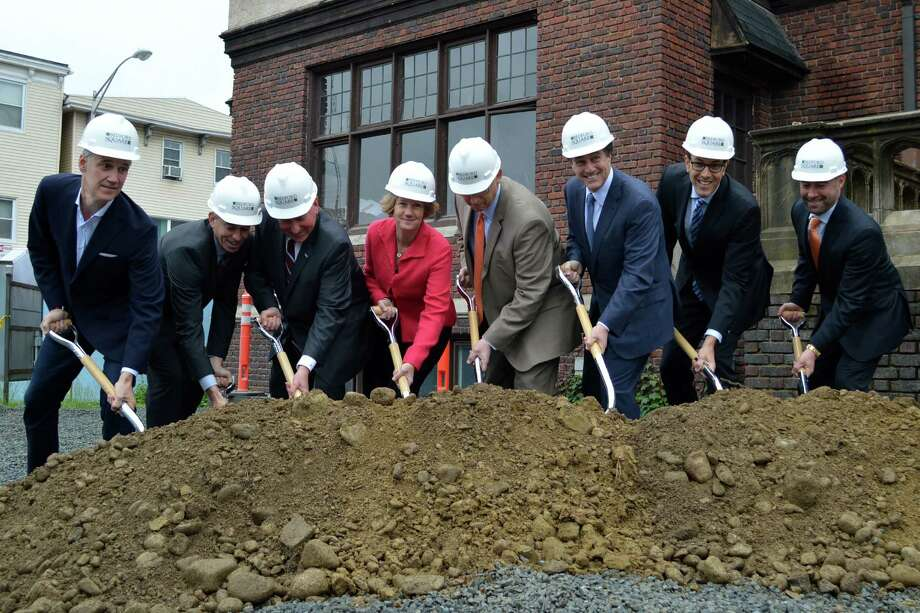 Shovels hit pay dirt Tuesday morning as the Bedford Square development team staged a ceremonial groundbreaking to kick off the consturction phase of its multi-faceted project rising on the former downtown site of the Westport Weston Family YMCA. Photo: Jarret Liotta / Westport News