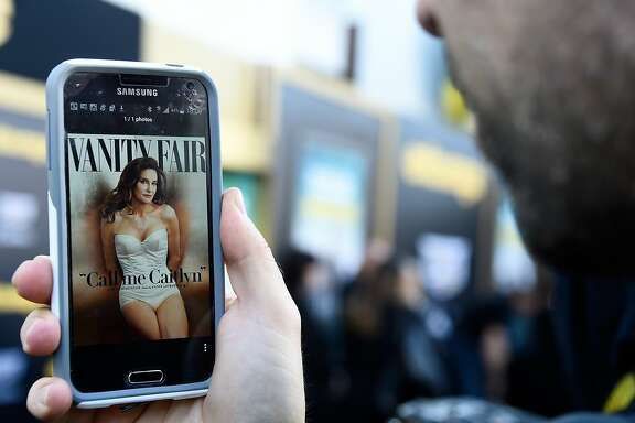 WESTWOOD, CA - JUNE 01: A photo editor views the July cover of Vanity Fair featuring Caitlyn Jenner on June 1, 2015 in Westwood, California. Formerly known as Bruce Jenner, Caitlyn Jenner is an Olympic atlete who came out publicly as transgender in a televised interview with Diane Sawyer. (Photo by Frazer Harrison/Getty Images)