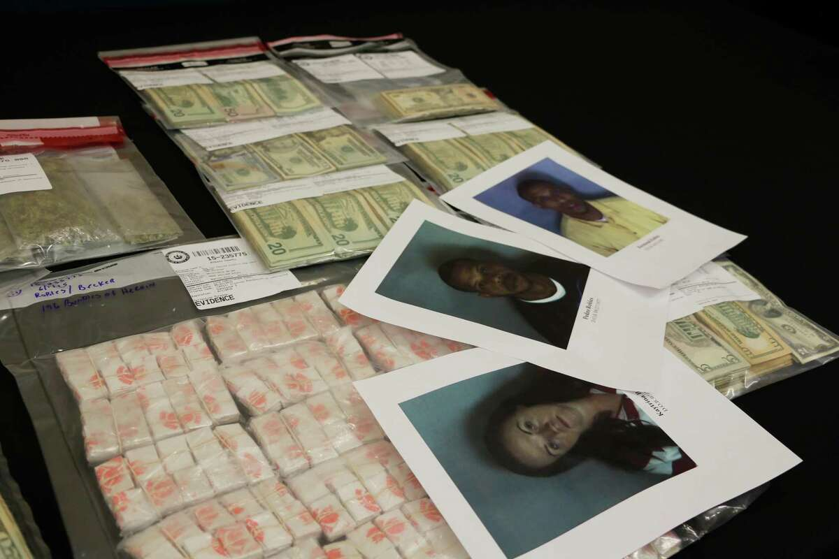 Evidence sits on the table during a press conference at the Albany County Courthouse on Tuesday morning, June 2, 2015, in Albany, N.Y. Albany County Sheriff Craig Apple?'s office arrested Pedro J. Robles, Katrina M. Becker, and Raymond A. Robles, and confiscated 2600 bags of Heroin, $15,561, and a loaded colt .380 handgun. (Olivia Nadel/ Special to the Times Union)