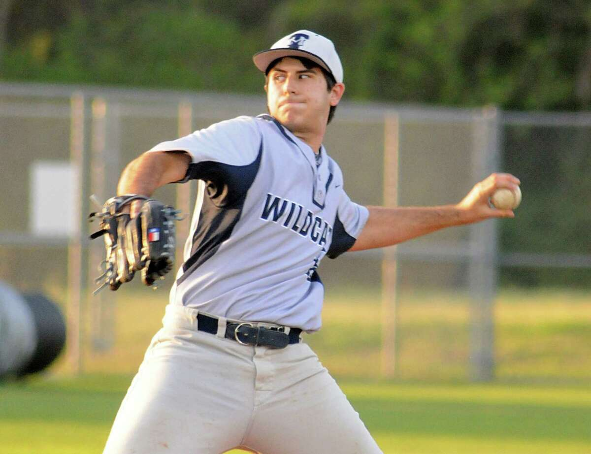 Tomball Memorial pitcher Dominic Robinson pirches during the Magnolia at Tomball Memorial baseball game. Photograph by David Hopper