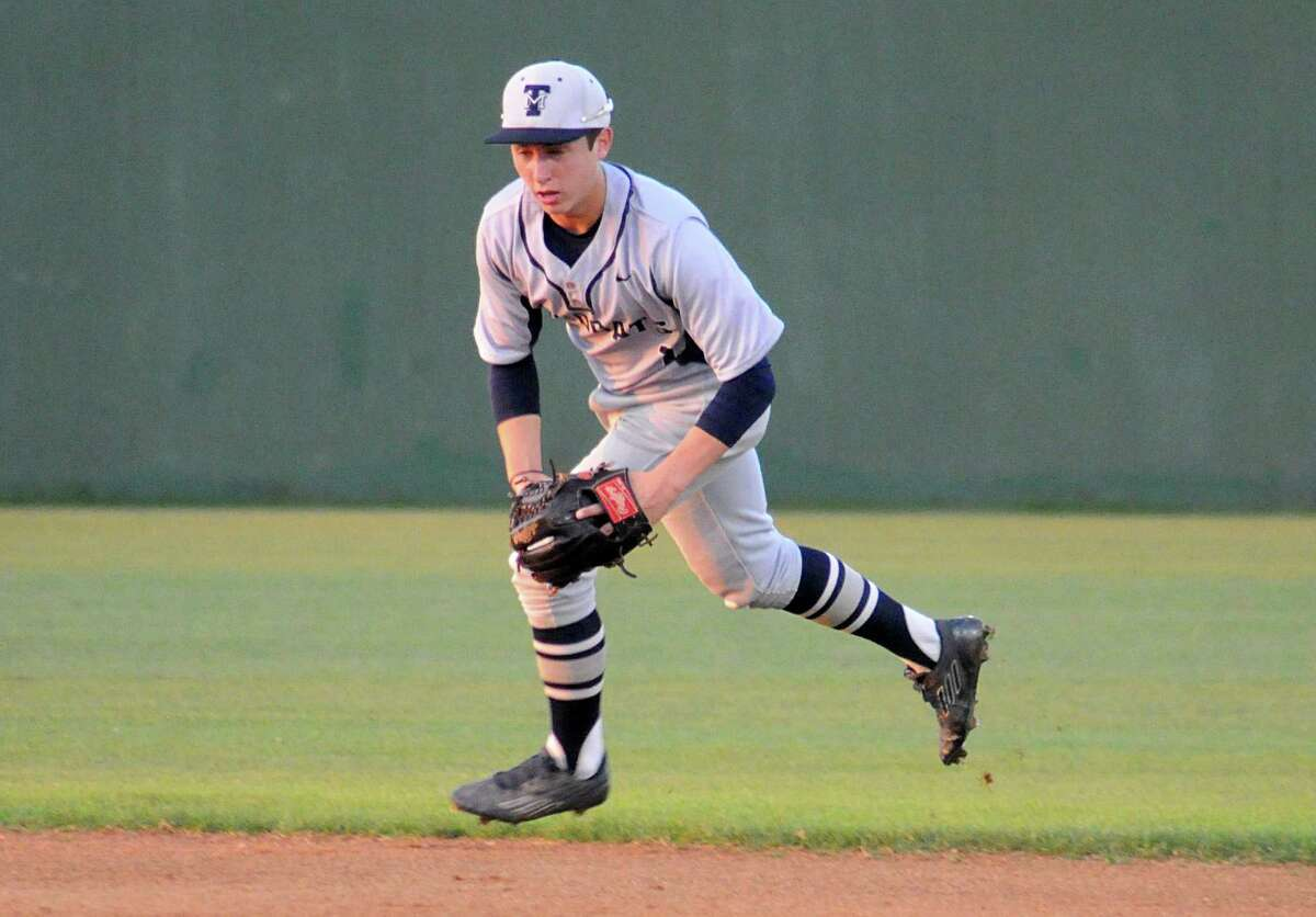 Tomball Memorial second baseman Trey Bills charges a slow roller during the Magnolia at Tomball Memorial baseball game. Photograph by David Hopper
