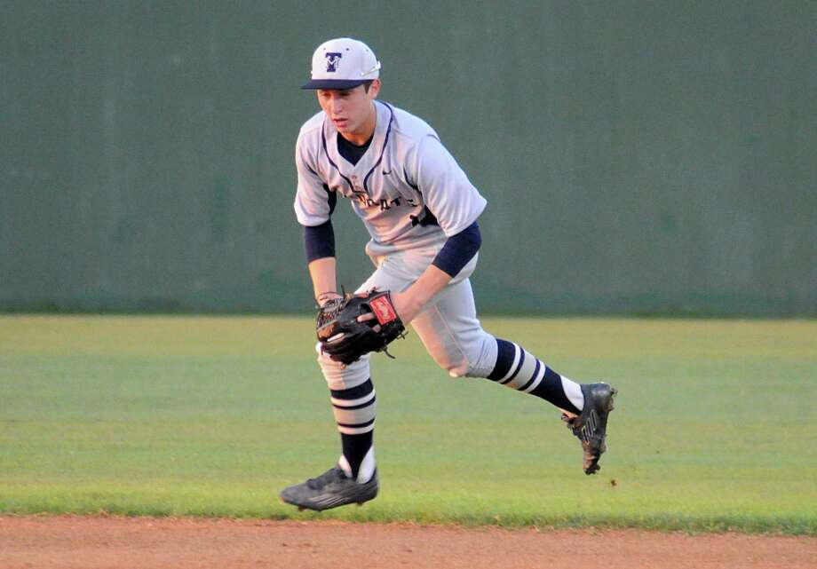 Tomball Memorial second baseman Trey Bills charges a slow roller during the Magnolia at Tomball Memorial baseball game. Photograph by David Hopper Photo: David Hopper, Freelance / freelance