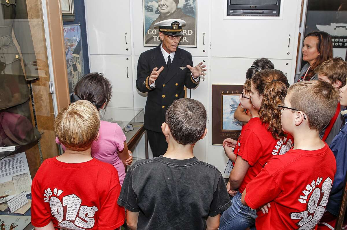 Commemorative Air Force Museum Curator Sam Hoynes talks with students from Katy Elementary about WWII planes and pilots at the Commemorative Air Force's Hanger located at West Houston Airport on May 22, 2015.