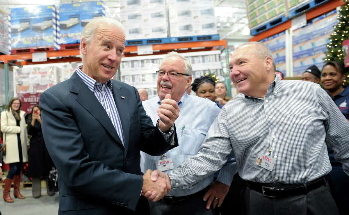 Love: Vice President Joe Biden, a regular guy's regular guy, shops there. Not a big surprise since its honchos tend to favor Democrats. Here Biden shakes hands with Costco CEO Craig Jelinek, right, as co-founder Jim Sinegal watches at center, after Biden arrived to shop at a Costco store in Washington, D.C. (AP Photo/Susan Walsh)
