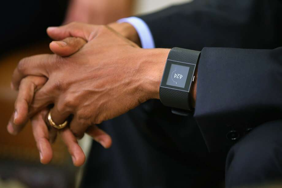 WASHINGTON, DC - MAY 29:  U.S. President Barack Obama wears a Fitbit Surge watch while talking to members of the news media in the Oval Office at the White House May 29, 2015 in Washington, DC. Calling it an essential piece of legislation for fighting terrorism, Obama demanded that the U.S. Senate pass the USA Freedom Act, a piece of legislation that would end bulk collection of Americans' metadata, improve the FISA court and other security reforms.  (Photo by Chip Somodevilla/Getty Images) Photo: Chip Somodevilla, Getty Images