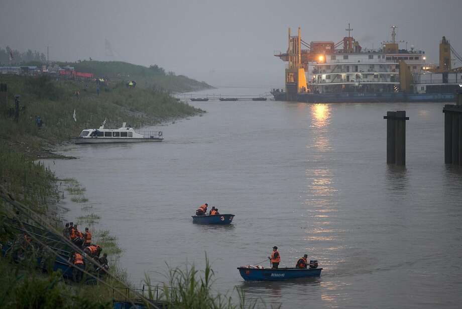 Chinese soldiers ride their boats to the embankment after their search and rescue operation near a capsized cruise ship on the Yangtze River in Jianli in central China's Hubei province, Tuesday, June 2, 2015. Divers on Tuesday pulled several survivors from inside the capsized cruise ship and searched for other survivors, state media said, giving some small hope to an apparently massive tragedy. (AP Photo/Andy Wong) Photo: Andy Wong, Associated Press
