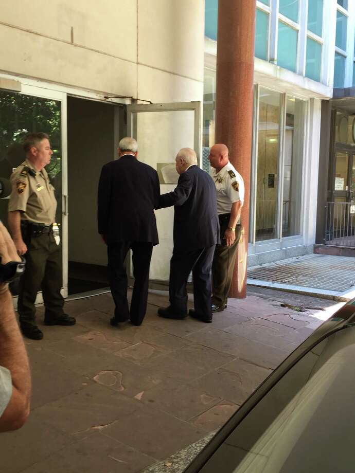 Tom Benson (center) enters the New Orleans courthouse after lunch Tuesday, the second day of his competency hearing. Photo: David Hendricks /San Antonio Express-News