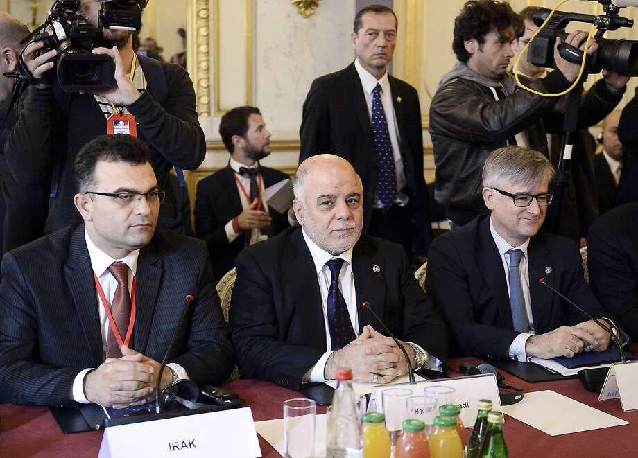 Iraqi Prime Minister Haider al-Abadi (center) meets in Paris with other members of the anti-Islamic State coalition to discuss strategy in fighting the jihadists. Photo: Stephane De Sakutin, Associated Press