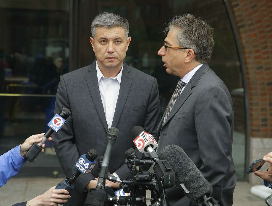 Murat Kadyrbayev (left) the father of Dias Kadyrbayev, 21, stands outside federal court in Boston with his interpreter, Alexander Tetradze, answering reporters' questions about the sentencing of his son, a college friend of Boston Marathon bomber Dzhokhar Tsarnaev, sentenced Tuesday to six years in prison after he apologized to the victims and their families for not calling police when he recognized photos of Tsarnaev as a suspect. Kadyrbayev pleaded guilty last year to obstruction of justice and conspiracy charges for removing items from Tsarnaev's dorm room after recognizing his friend in photos released by the FBI. Photo: Stephan Savoia, Associated Press