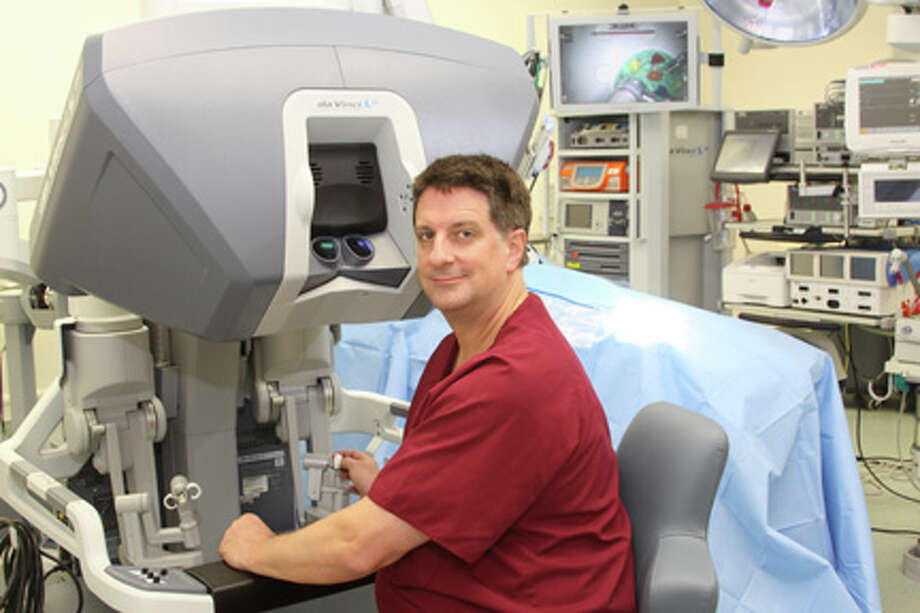 Surgeon Kevin Dean M.D. at the control panel of the Da Vinci surgical system. courtesy photo
