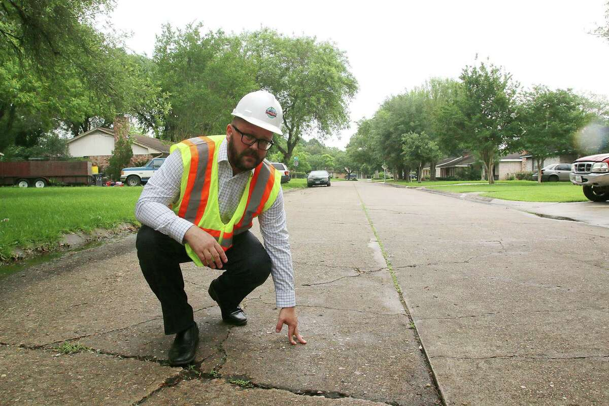 Pearland Assistant Public Works Director Michael Leech shows why the city plans to rebuild the roads in Regency Park subdivision.