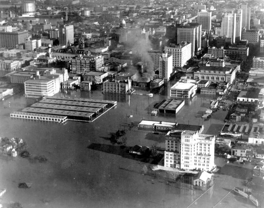 Looking east over downtown, December 1935. White building at foreground is the criminal courthouse, where the back of Bayou Place is today. Structure at right-center is the farmer's market, where Wortham Center is today. Photo: J.R. Gonzales