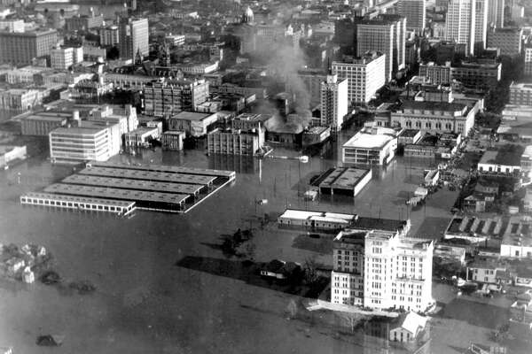 Looking east over downtown, December 1935. White building at foreground is the criminal courthouse, where the back of Bayou Place is today. Structure at right-center is the farmer's market, where Wortham Center is today.