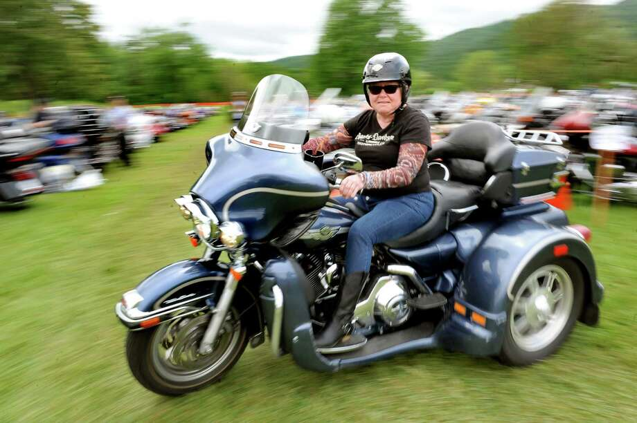 Donna Truex of Shamong, N.J. drives out of the motorcycle parking area during Americade on Tuesday, June 2, 2015, in Lake George, N.Y. Truex, who owns six motorcycles, said she's been coming to this event for 18 years. (Cindy Schultz / Times Union) Photo: Cindy Schultz / 00032079A