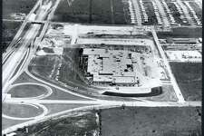 An undated aerial photo of the North Star Mall site shows the Loop 410 cloverleaf in the lower left corner.