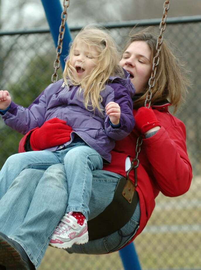 Jennifer and her daughter Alexandra Black, 4, of Danbury, play at Lake Kenosia Town Park in Danbury, Friday Morning, March 12, 2010. Photo: Chris Ware / The News-Times