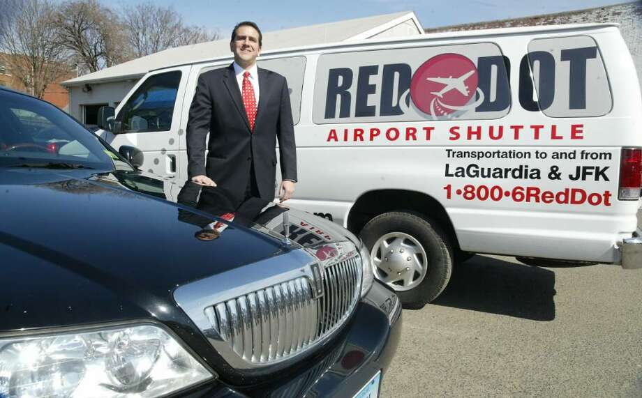 Jeff Serlin, owner of Chauffered Limousine and Red Dot Airport Shuttle on State Street in Bridgeport, Tuesday, March 9, 2010, carries on the family tradition of owning a business in Bridgeport. Photo: Phil Noel / Connecticut Post