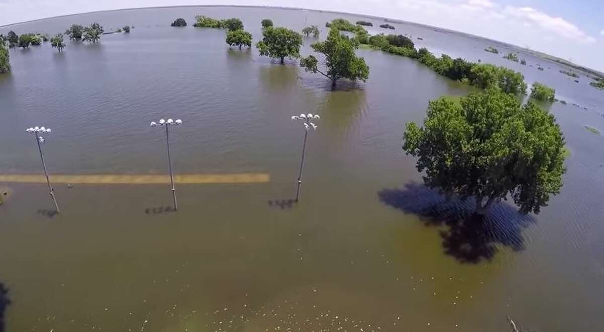 An 18-hole Texas golf course looked more like a watering hole after the torrential Memorial Day floods submerged it underwater.