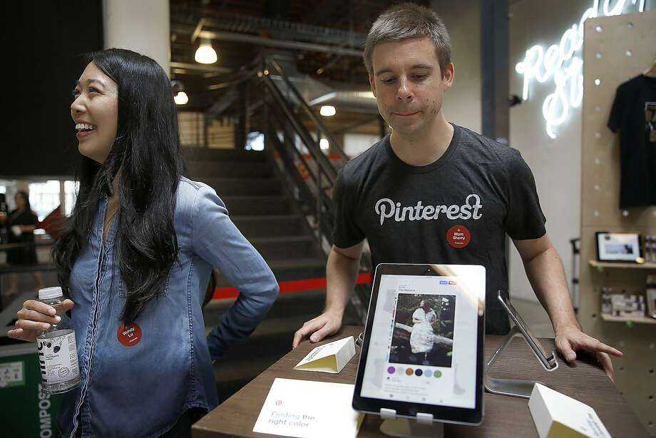 Engineers Wendy Lu (left) and Marc Sherry (right) show the new buyable pins at Pinterest in San Francisco, California, on Tuesday, June 2, 2015. Photo: Liz Hafalia, The Chronicle