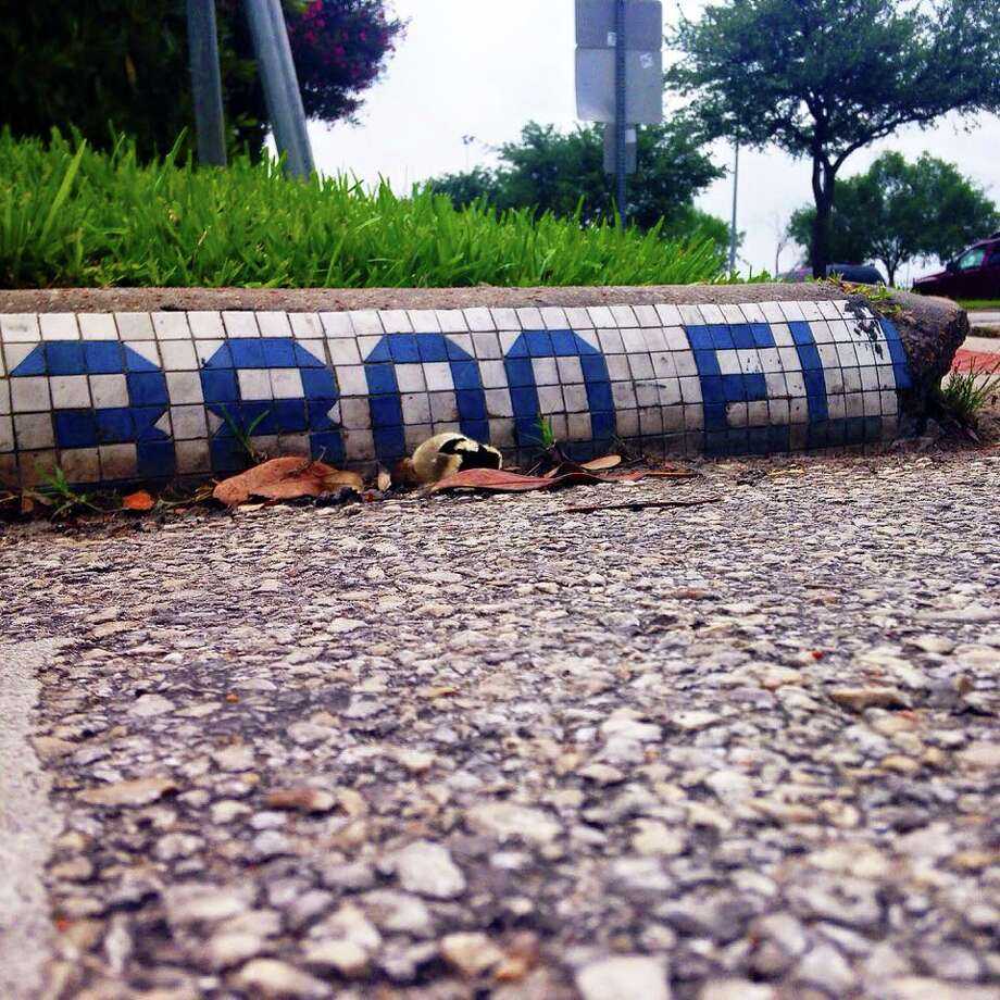 Houston resident Joey Sanchez is on a mission to locate and document every one of Houston's surviving vintage blue curb tiles. Some were installed nearly a century ago and most have been lost to urban development. Sanchez takes photo submissions via his official website and an Instagram hash tag, #BlueTileProject. Photo: Jose Sanchez / Blue Til Project