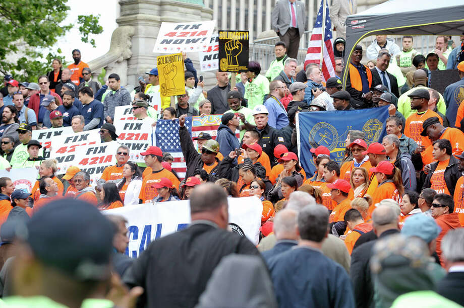 Building trades workers take part in a rally outside the Capitol on Tuesday, June 2, 2015, in Albany, N.Y.  The participants were calling for changes to the 421-a tax program.    (Paul Buckowski / Times Union) Photo: Albany Times Union