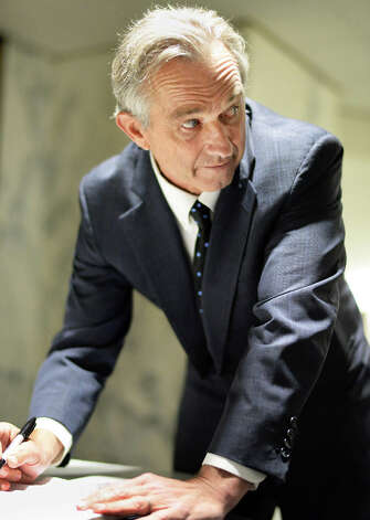 Robert F. Kennedy, Jr., works on his notes before a news conference in the LOB in opposition to New York Assembly Bill A791 to mandate meningococcal injections for sixth and eleventh graders Tuesday June 2, 2015 in Albany, NY.  (John Carl D'Annibale / Times Union) Photo: John Carl D'Annibale, Albany Times Union / 00032111A