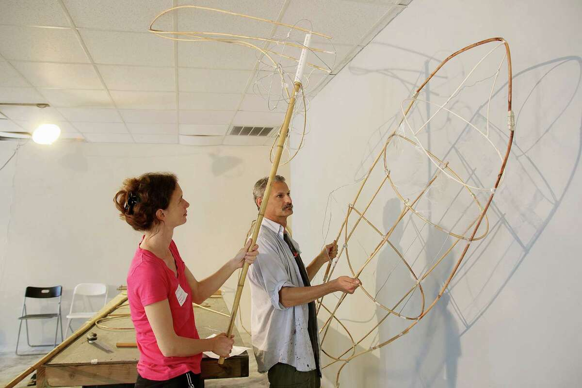 Sophia Michahelles and Alex Kahn of Processional Arts Workshop check on the progress of art pieces that will be used as illuminated sculptures to mark the opening of an upgraded Buffalo Bayou Park. The Buffalo Bayou Partnership is planning a parade of the sculptures to mark the opening and invites volunteers to construct art to carry in a commemorative procession. Sophia Michahelles and Alex Kahn checking on the progress of some of the pieces at Canal Street Gallery. Photo by Pin Lim.