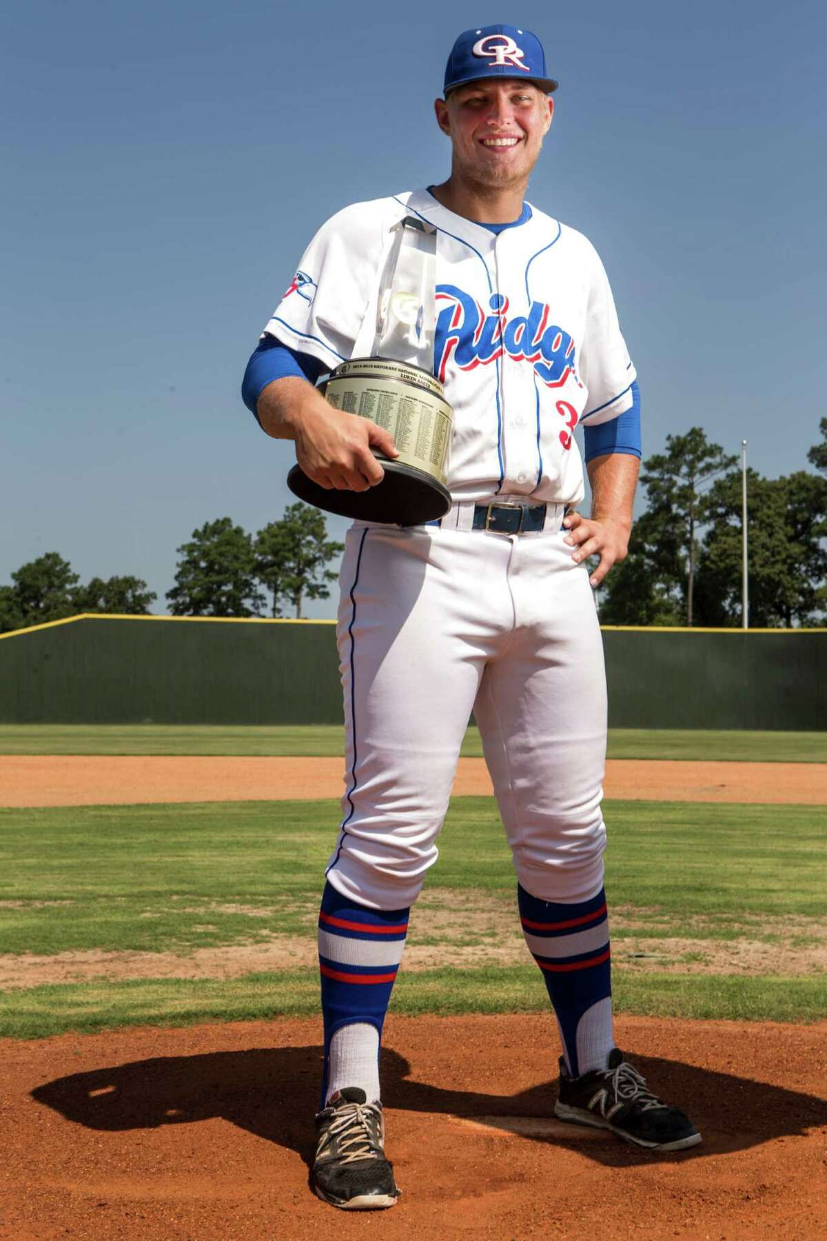 Oak Ridge High School senior baseball player Luken Baker poses for a portrait after being named the Gatorade National Baseball Player of the Year during a ceremony on Tuesday, June 2, 2015, in Conroe. The award recognizes outstanding athletic excellence as well as high standards of academic achievement and exemplary character demonstrated on and off the field. ( Brett Coomer / Houston Chronicle )