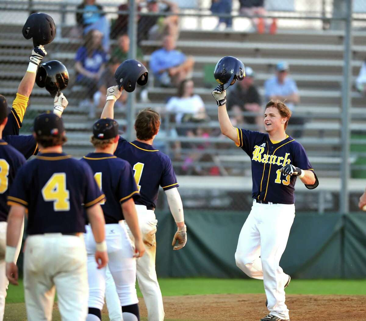Cy Ranch traveled to Cy Falls for a UIL District 17-6A baseball game. Right, Cy Ranch's Marshall Skinner (13) is met at home plate after hitting a two run home run.